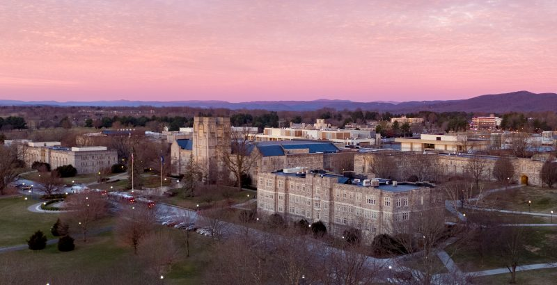 Aerial sunrise view of Burruss Hall and surrounding buildings